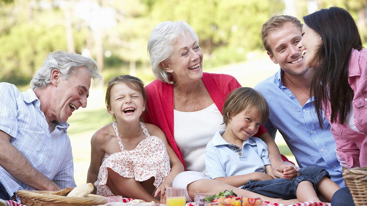 retired couple enjoys family picnic