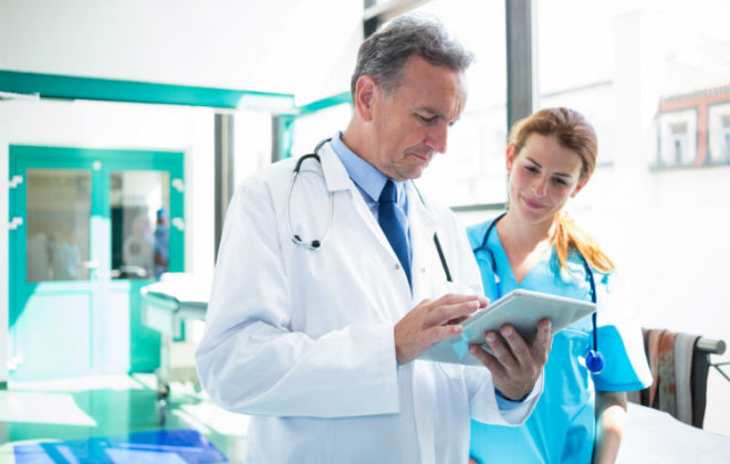 A doctor and nurse discuss How Electronic Health Records Will Change Healthcare