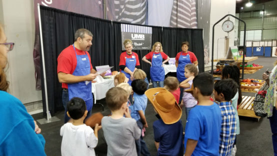UMB volunteers speaking to children at the American Royal School Tours