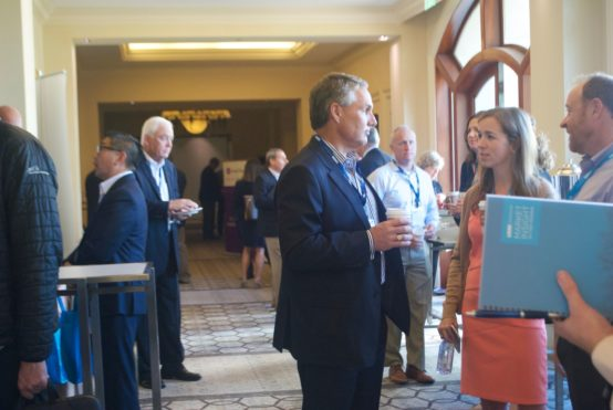 A group of people gather outside of the asset servicing trends and challenges conference.