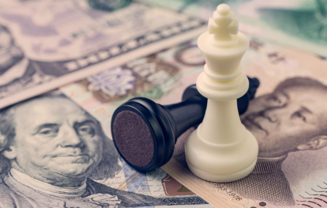 Two chess pieces on Chinese and U.S. currency symbolize a trade war with china.