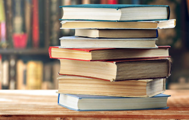 A stack of must read books on investing