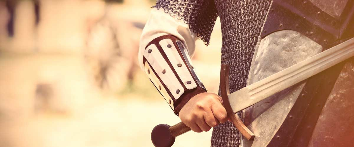 The Federal Reserve represented by a knight in shining armor stands with sword and shield.