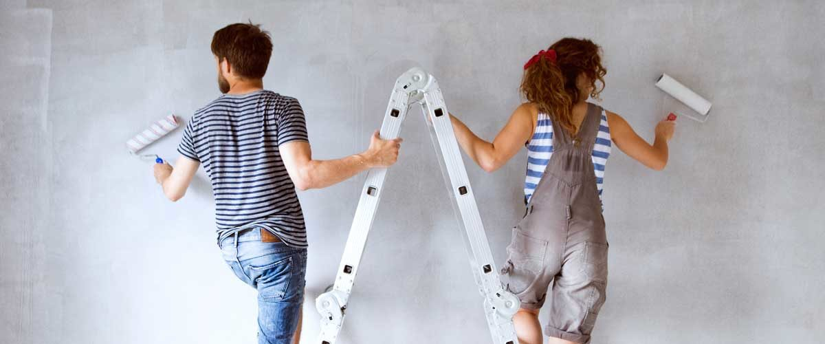 A couple that used a home equity line of credit are painting a room in their house.