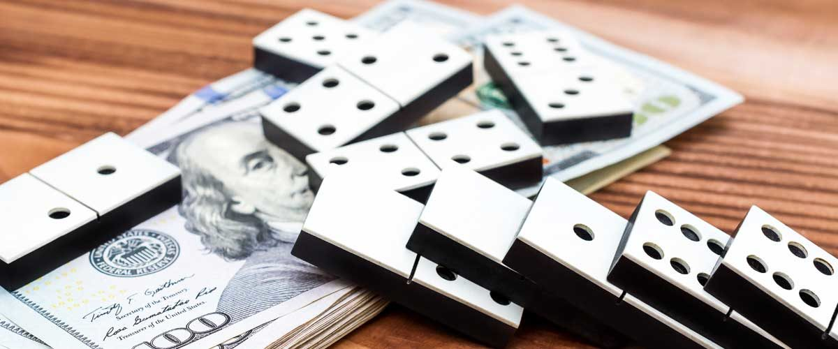 Will there be a recession in 2019? Dominos falling on dollar bills symbolize economic indicators