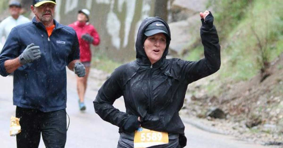 Jill Calton leader of UMB Fund Services alternative investments running in a rainy marathon