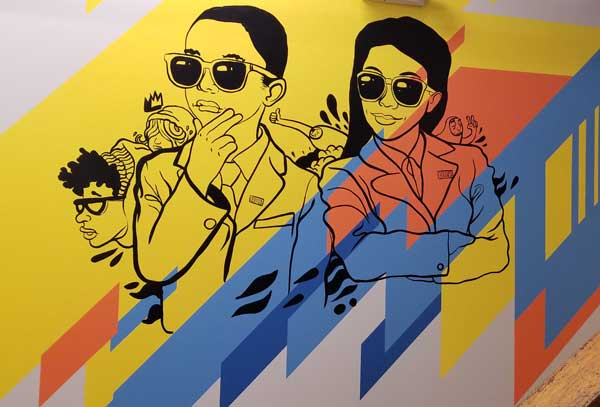 The murals inside the School of Economics at UMB are meant to reflect student diversity.