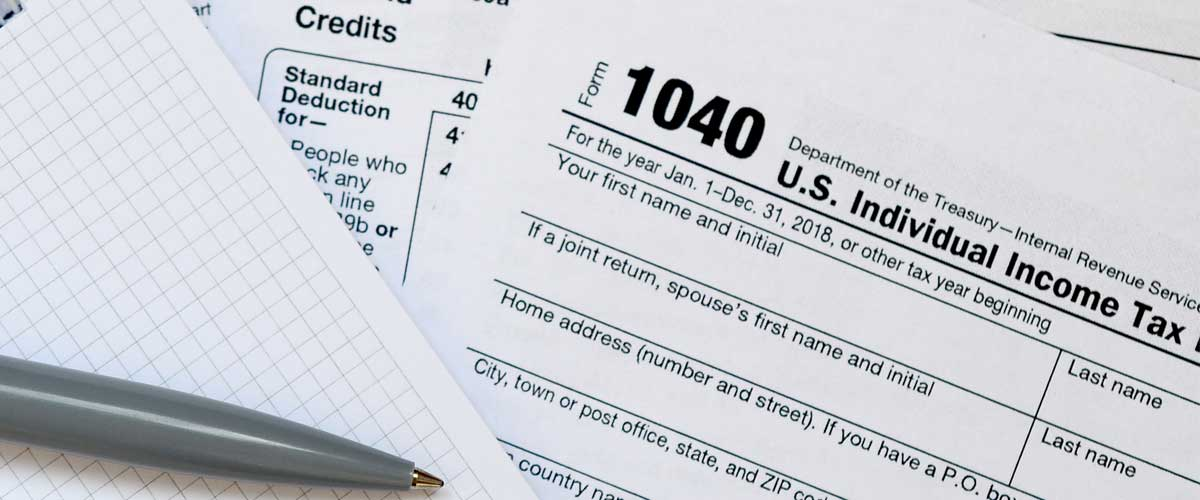 Paperwork with Tax terms you need to know on them.