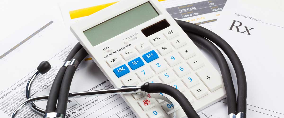The CARES Act and Healthcare Benefits represented by a stethoscope and calculator.