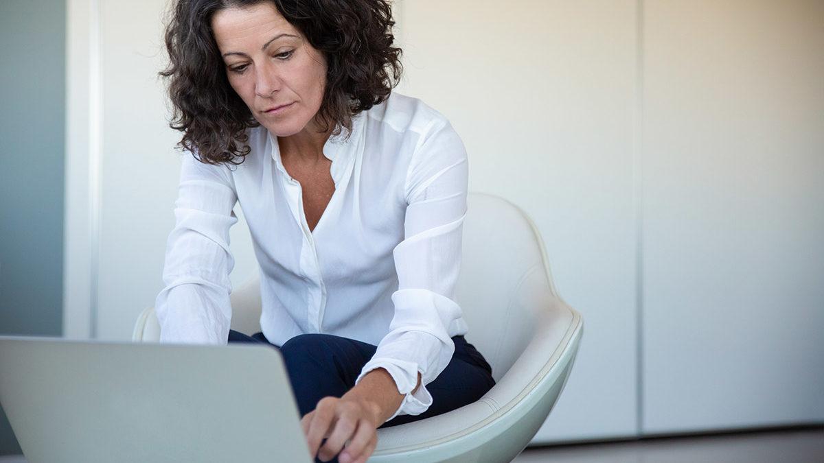 woman-on-laptop-budgeting