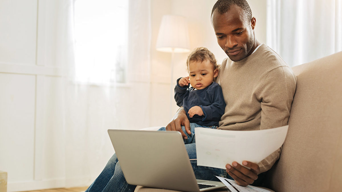father reviewing financial plan
