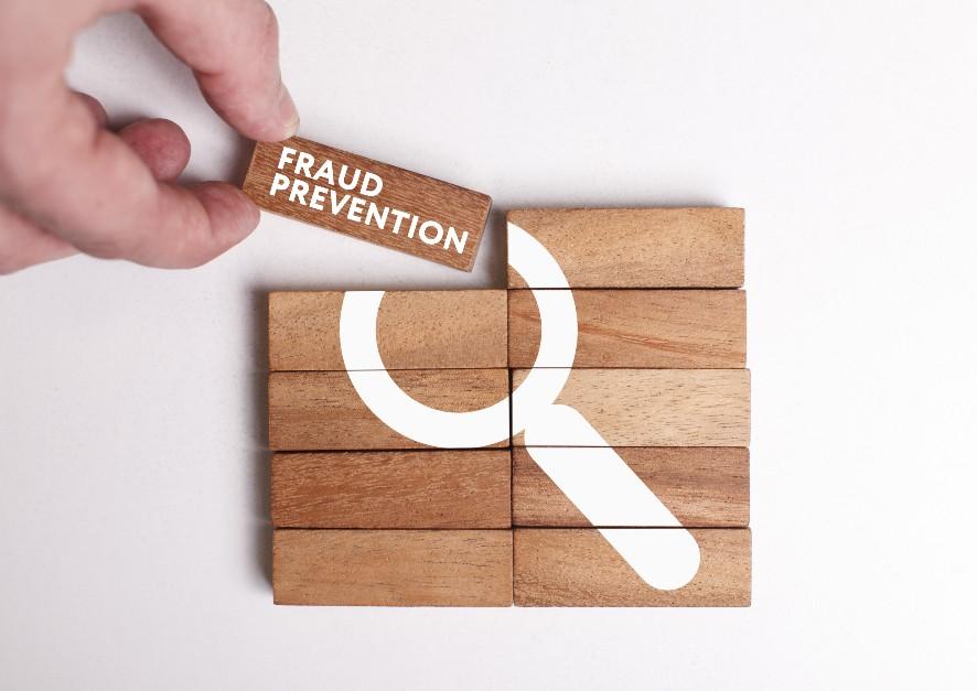 A series of woodblocks representing building defense against cyber fraud.
