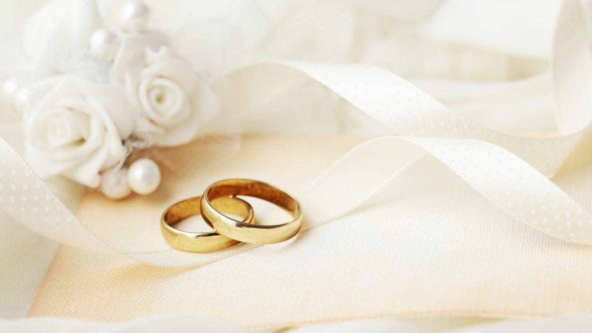 bigstock two wedding rings and wedding 346457053 1