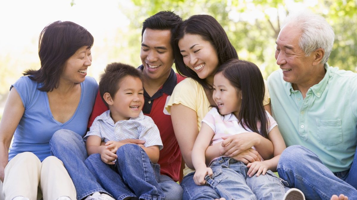bigstock Extended Families Sitting Outd 4132297 1